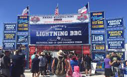 Patrons line up in front of Austin's Texas Lightning BBQ booth
