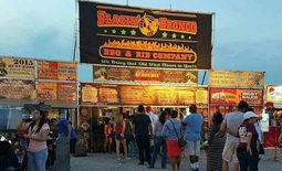 People lining up at Blazin' Bronco BBQ booth